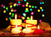 Beautiful candles and decor on wooden table on bright background — Stockfoto