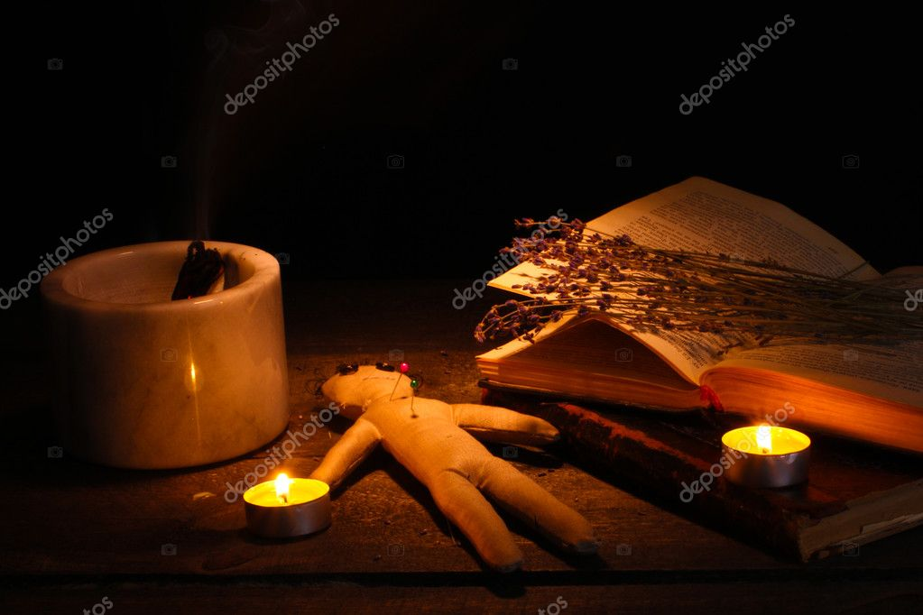 Voodoo doll boy on a wooden table in the candlelight — Stock Photo #9184877