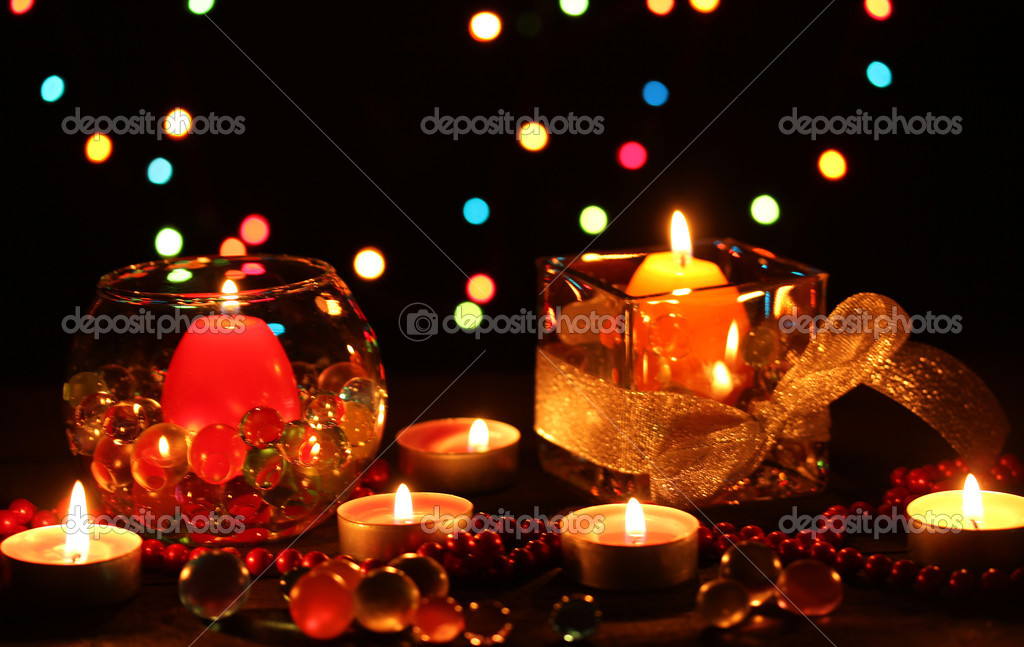 Wonderful composition of candles on wooden table on bright background — Stock Photo #9185006