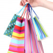Bright gift bags in hand isolated on white — Stock Photo #9197715