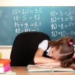 Little schoolgirl sleep in classroom near blackboard — Stock Photo #9210599