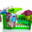 Clothes in green plastic basket isolated on white — Stock Photo #9210753