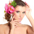 Beautiful girl with flowers in her hair isolated on white - Stock Photo