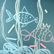 Two fishes, сhild's drawing with chalk — Stock Photo #9210890
