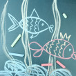 Two fishes, сhild's drawing with chalk - Stock Photo
