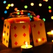 Candles and playing cards on wooden table on bright background - Stock Photo