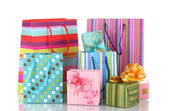 Bright gift bags and gifts isolated on white — Zdjęcie stockowe