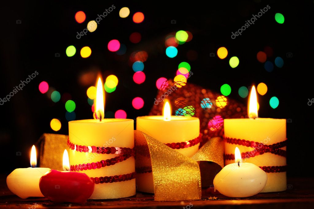 Beautiful candles on wooden table on bright background — Stock Photo #9210879