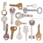 Many metal keys isolated on white — Stock Photo