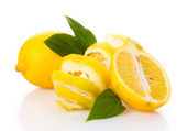 Ripe lemons with leaves isolated on white — Stock Photo