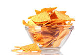Tasty potato chips in transparent bowl isolated on white — Stock Photo