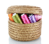 Bright bobbin thread in basket isolated on white — Stock Photo