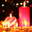 Wonderful candles on wooden table on bright background — Stockfoto #9244366