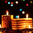 Wonderful candles on wooden table on bright background - Stock Photo
