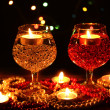Stock Photo: Amazing composition of candles and glasses on wooden table on bright backgr