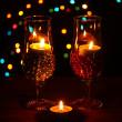 Amazing composition of candles and glasses on wooden table on bright backgr — Stock Photo #9244382