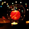 Candles and playing cards on wooden table on bright background - Foto de Stock