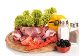 Pieces of raw meat and vegetables on wooden board isolated on white — Stock Photo