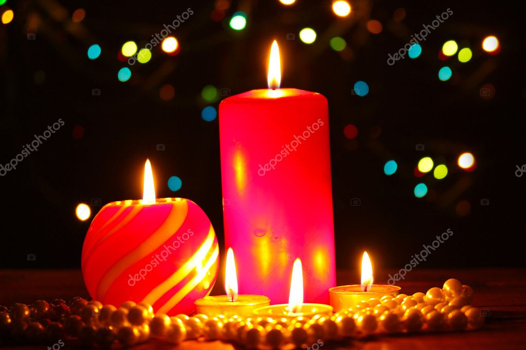 Wonderful candles on wooden table on bright background — Stock Photo #9244362