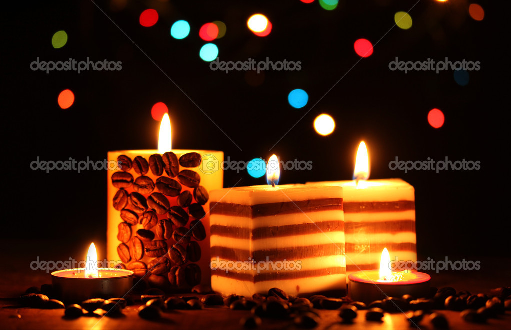 Wonderful candles on wooden table on bright background — Stock Photo #9244374