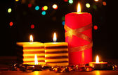Wonderful candles on wooden table on bright background — Stock Photo