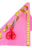Scissors, measuring tape and pattern on fabric isolated on white — Stock Photo