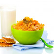 Tasty cornflakes in green bowl and glass of milk isolated on white — Stock Photo