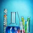 Test-tubes on blue background — Stock Photo #9298159