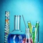 Test-tubes on blue background — Stock Photo