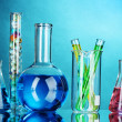 Test-tubes on blue background — Stock Photo