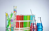 Test-tubes with liquid on gray background — Stock Photo