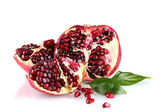 Ripe pomegranate fruit with leaves isolated on white — Stock Photo