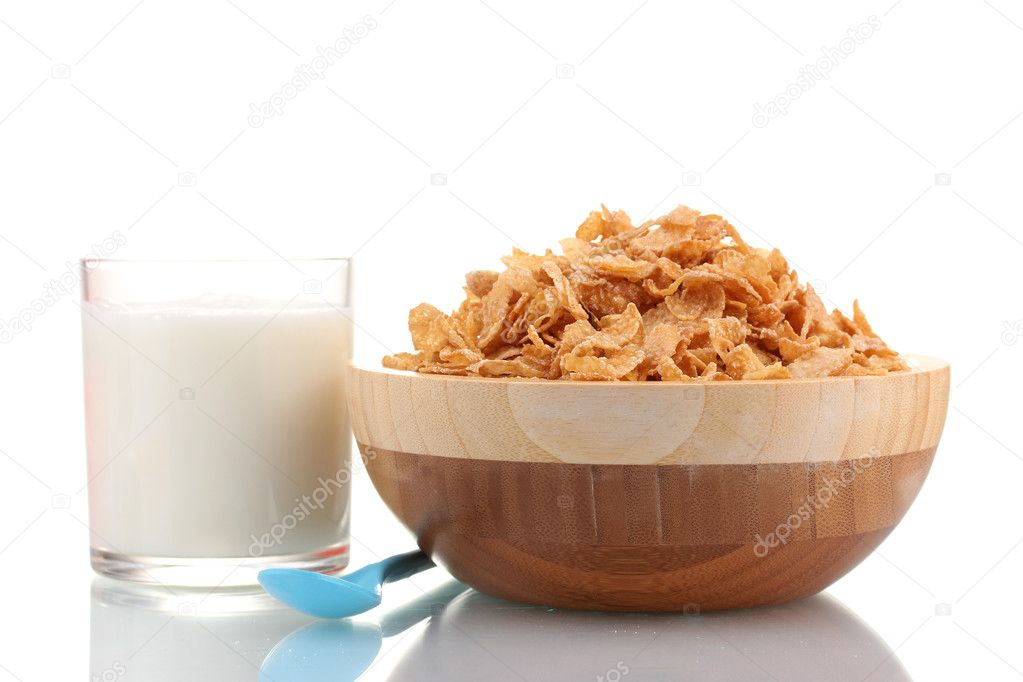 Tasty cornflakes in wooden bowl and glass of milk isolated on white — Stock Photo #9302850