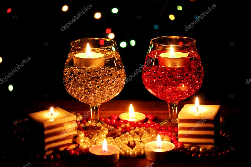 Amazing composition of candles and glasses on wooden table on bright background — Stock Photo #9303356