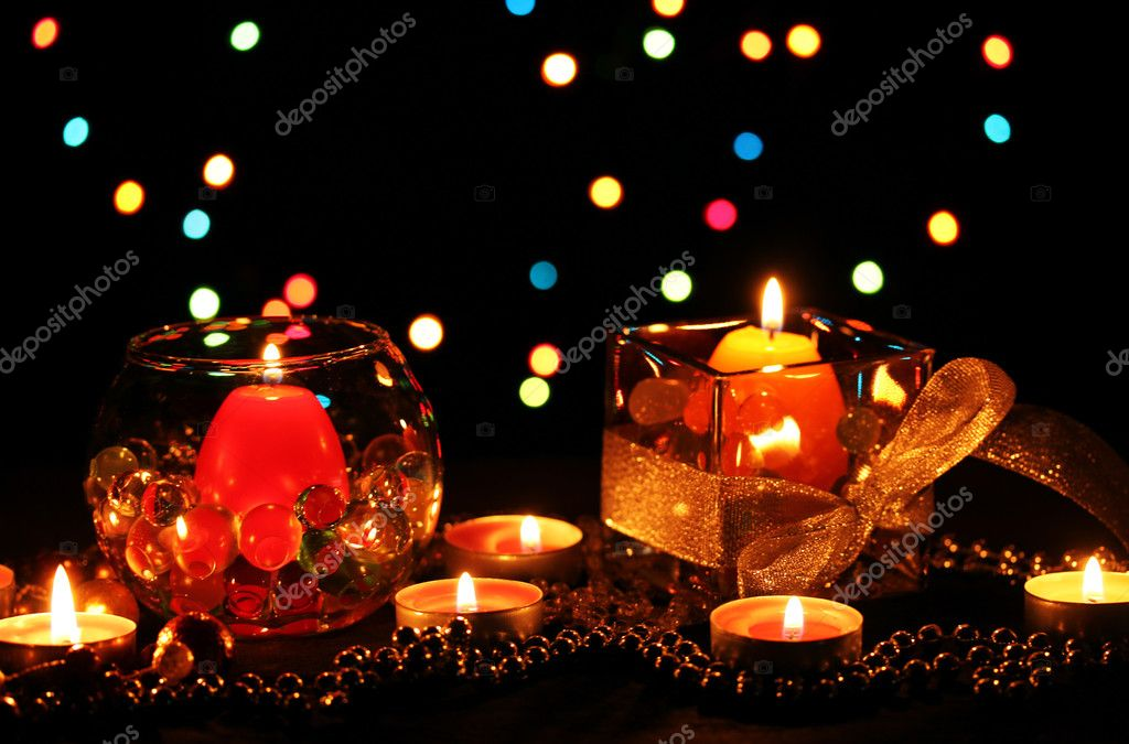 Wonderful composition of candles on wooden table on bright background — Stock Photo #9303369