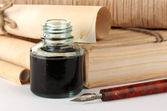 Old books, ink pen and ink bottle isolated on white — Stock Photo