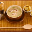 Tasty soup on wooden mat — Stock Photo #9357111