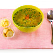 Tasty chicken stock with noodles on pink tablecloth — Stock Photo
