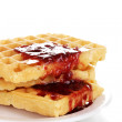 Tasty waffles with jam on plate close-up isolated on white — Stock Photo #9357211