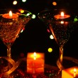 Amazing composition of candles and glasses on wooden table close-up on bright background — Stock Photo