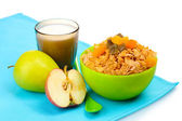 Tasty cornflakes in green bowl, apples and glass of milk isolated on white — Stock Photo