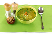 Tasty chicken stock with noodles on green tablecloth — Foto de Stock