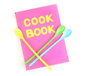 Pink cookbook and kitchenware isolated on white — Stock Photo
