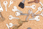 Keys on cork background — Stock Photo