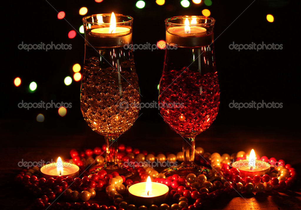 Amazing composition of candles and glasses on wooden table on bright background — Stock Photo #9357251
