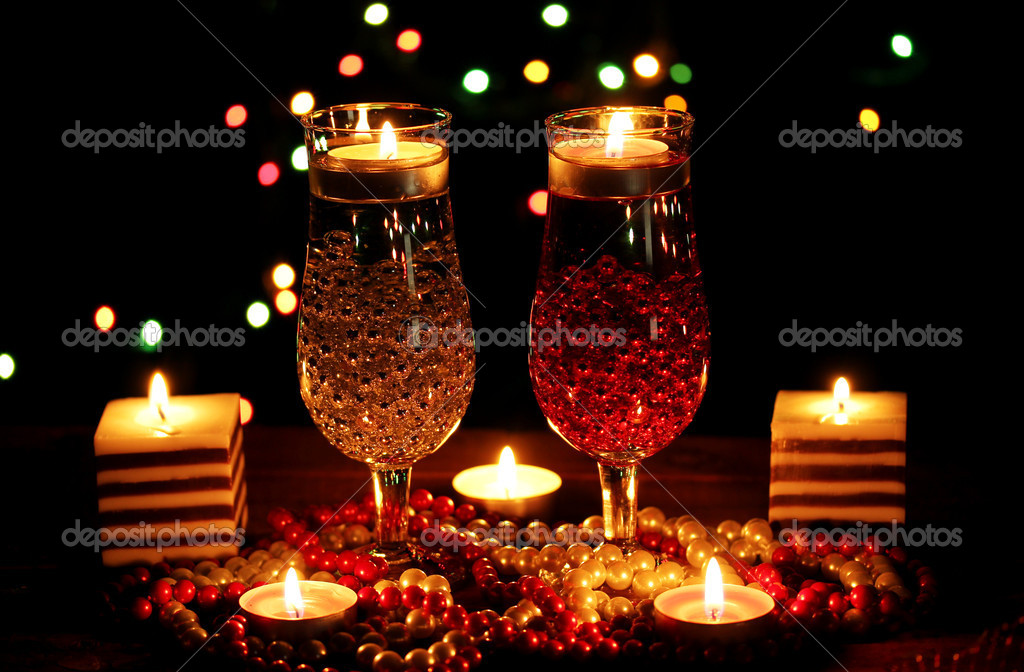 Amazing composition of candles and glasses on wooden table on bright background — Stock Photo #9357252