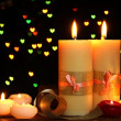 Beautiful candle and decor on wooden table on bright background — Stock Photo