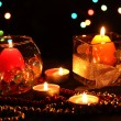 Wonderful composition of candles on wooden table on bright background - Stock Photo