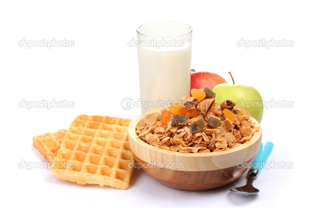 Tasty cornflakes in wooden bowl, apples and glass of milk isolated on white — Stock Photo #9373257