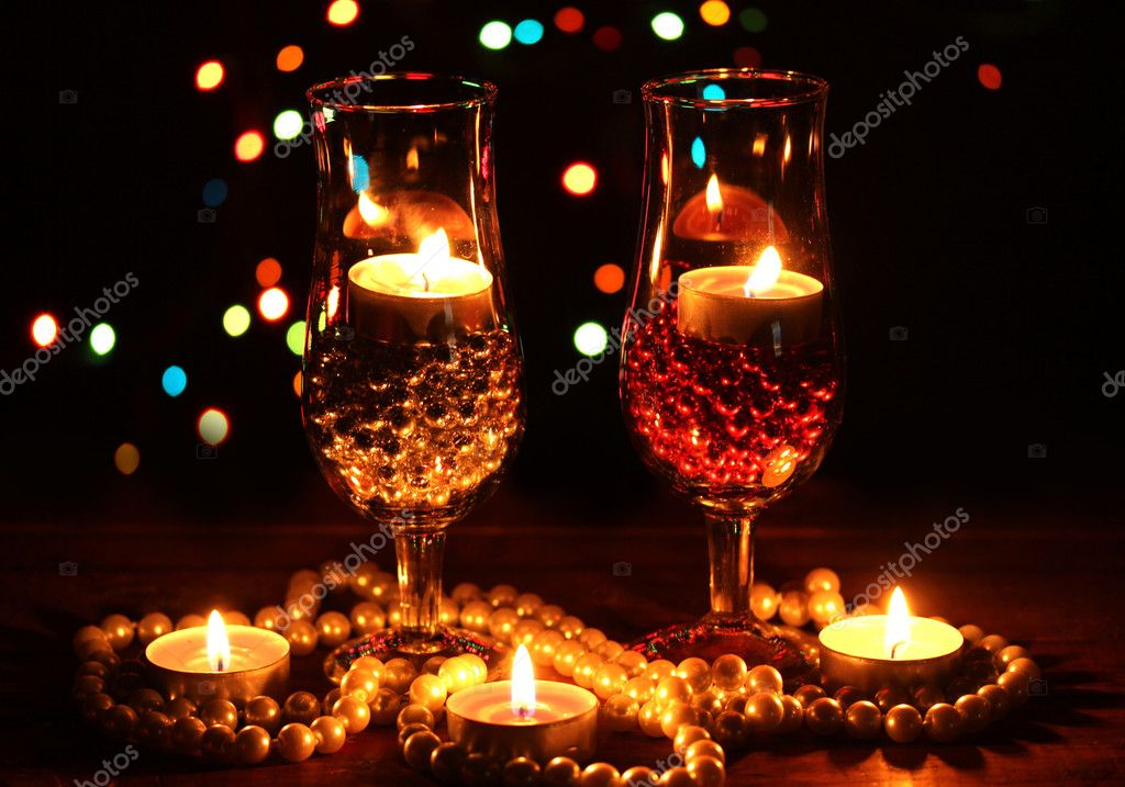 Amazing composition of candles and glasses on wooden table on bright background — Stock Photo #9373302